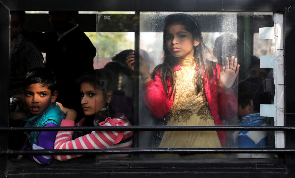 People observe a protest against a new citizenship law from a bus in New Delhi, India, 3 January 2020.