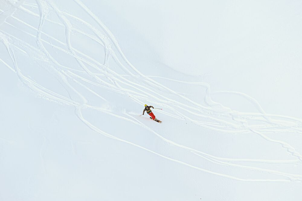 A person is skiing in the 'Gorky Gorod' resort in Russia's Sochi.