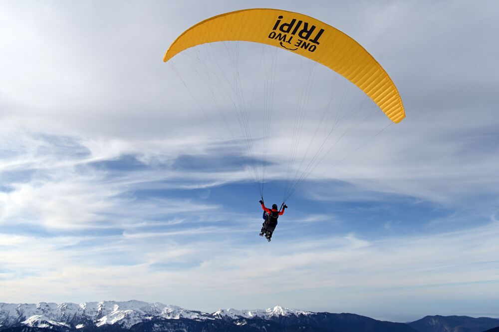 A person takes a paragliding ride in the 'Rosa Khutor' ski resort in Sochi