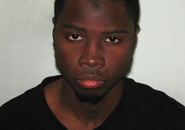 An undated handout picture received from the Metropolitan Police Service (MPS) on February 19, 2015 shows a custody picture of Brusthom Ziamani, who has been found guilty of engaging in preparation of terrorist attacks. Ziamani had been arrested on August 19, 2014 in the street as part of a joint police and MI5 intelligence operation, after officers found a knife and hammer in his rucksack
