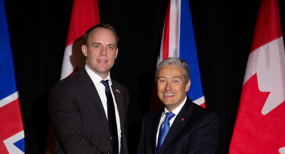 Dominic Raab with Francois-Philippe Champagne in Canada