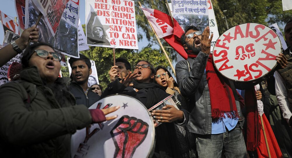 Indian students shout slogans during a protest against a recent attack on students by masked men inside Jawaharlal Nehru University, in New Delhi, India, Thursday, Jan. 9, 2020
