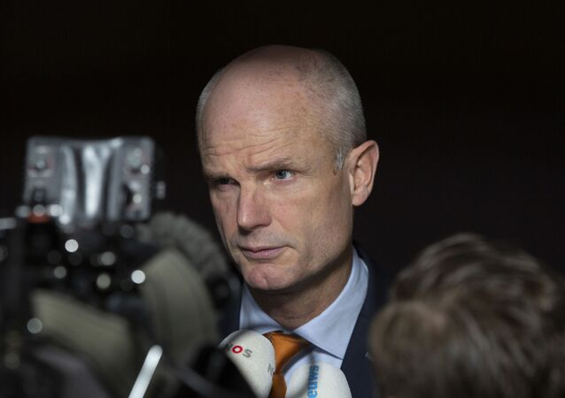Dutch Foreign Minister Stef Blok speaks with the media as he arrives for a meeting of EU foreign ministers at the European Convention Center in Luxembourg, Monday, Oct. 14, 2019