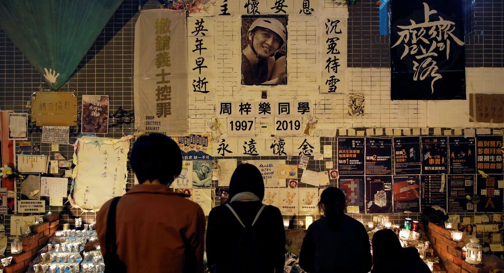People gather near a makeshift memorial as they pay tribute to Chow Tsz-lok, 22, a university student who died two months ago after he fell from a car park during a protest, at Tseung Kwan O district in Hong Kong, China, January 8, 2020
