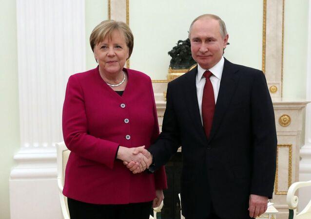 Russian President Putin meets with German Chancellor Merkel