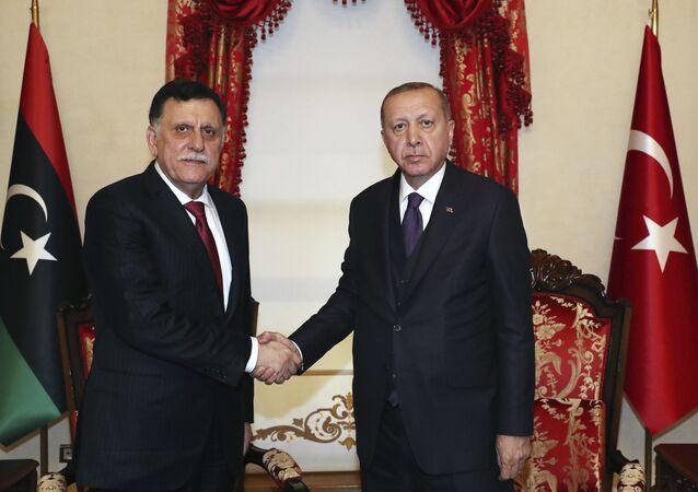 Recep Tayyip Erdogan and Fayez al Sarraj in Istanbul