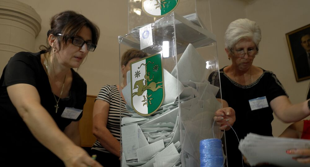 Members of the election committee check the ballots after the presidential election in central Sukhumi, the capital of the republic of Abkhazia, on August 24, 2014.