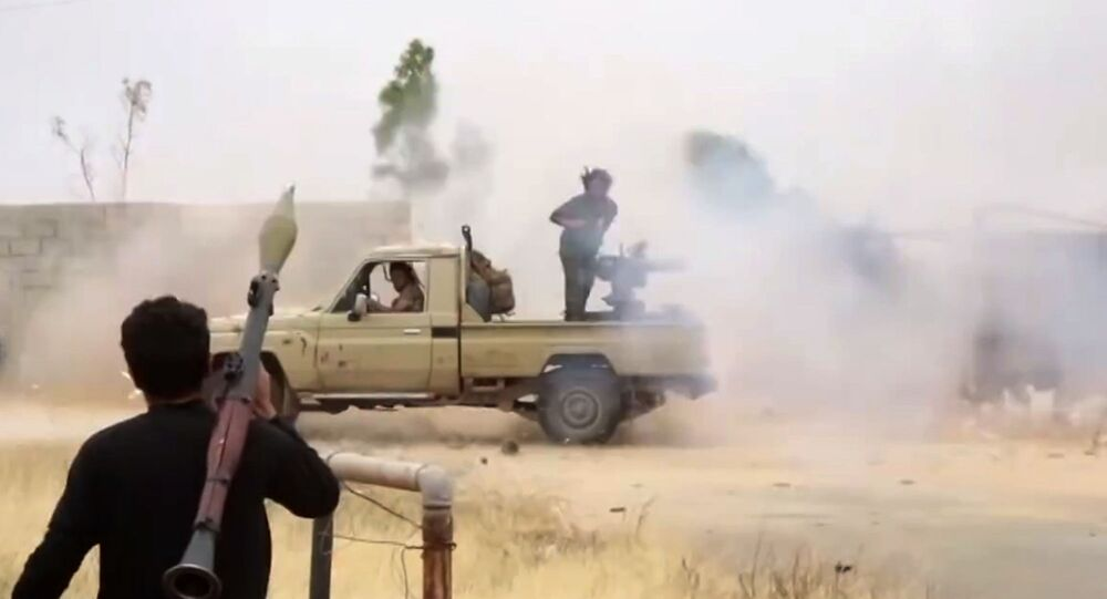 This image grab taken from a video published on the Facebook page of the War Information Division of military strongman Khalifa Haftar's self-proclaimed Libyan National Army (LNA) on May 26, 2019 shows fighters loyal to Haftar reportedly advancing on a road south of the capital Tripoli.