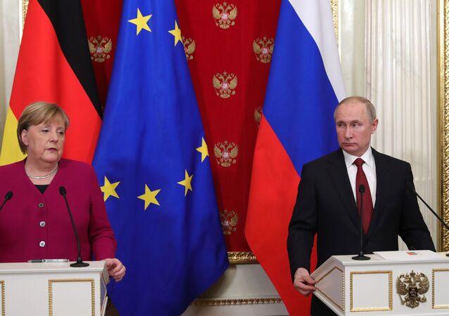 German Chancellor Angela Merkel and Russian President Vladimir Putin speak at a press conference at the Kremlin on Saturday, 11 January 2020