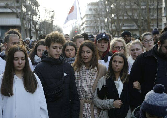 Doria Chouviat (C) and her relatives attend on January 12, 2020 a rally in the streets of Levallois for her late husband, Cedric Chouviat, a delivery driver who died after being held on the ground during a tense police check on January 3.