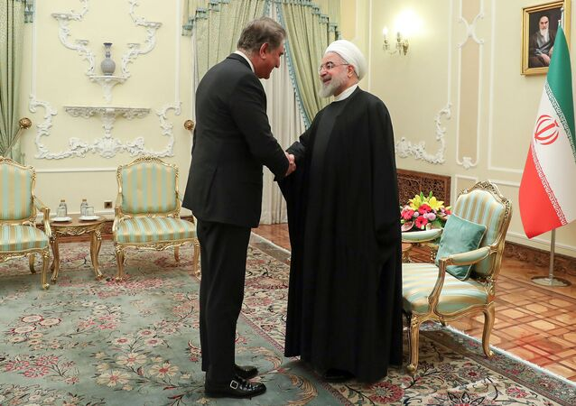 A handout picture provided by the official website of the Iranian Presidency shows Pakistan's Foreign Minister Shah Mahmood Qureshi (L) meeting with Iranian President Hassan Rouhani in Tehran on January 12, 2020