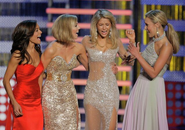 Miss Michigan Kirsten Haglund, second from right, reacts as she is named Miss America 2008 during the Miss America Pageant at the Planet Hollywood hotel and casino in Las Vegas, Saturday, Jan. 26, 2008.