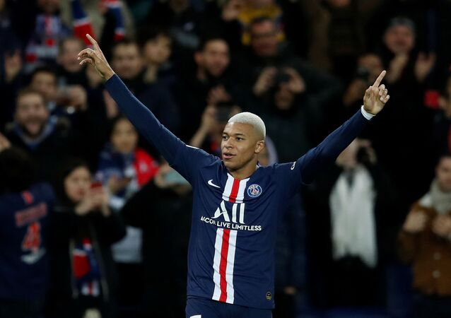 Soccer Football - Ligue 1 - Paris St Germain v Amiens SC - Parc des Princes, Paris, France - December 21, 2019   Paris St Germain's Kylian Mbappe celebrates scoring their third goal