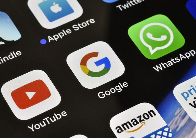 The icons of Google, WhatsApp and YouTube are pictured on an iPhone on Thursday, Nov. 15, 2018 in Gelsenkirchen, Germany