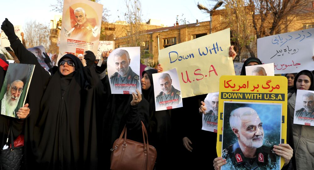Protesters chant slogans and hold up posters of Gen. Qassem Soleimani during a demonstration in front of the British Embassy in Tehran, Iran, Sunday, Jan. 12, 2020