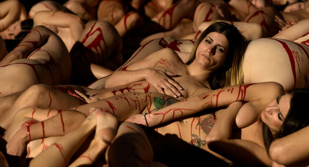 Graphic content / Naked activists covered with fake blood take part in a protest against fur trade, called by international non profit animal rights organisation AnimaNaturalis, in Madrid on January 12, 2020