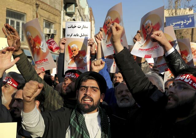 Hardline protesters chant slogans while holding up posters of Gen. Qassem Soleimani in front of British Embassy in Tehran, Iran, Sunday, Jan. 12, 2020