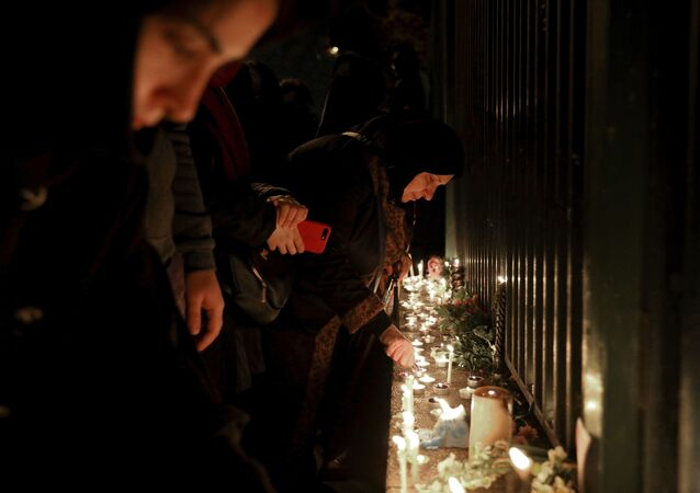 People gather for a candlelight vigil to remember the victims of the Ukraine plane crash, at the gate of Amri Kabir University that some of the victims of the crash were former students of, in Tehran, Iran, Saturday, Jan. 11, 2020. Iran on Saturday, Jan. 11, acknowledged that its armed forces unintentionally shot down the Ukrainian jetliner that crashed earlier this week, killing all 176 aboard, after the government had repeatedly denied Western accusations that it was responsible.