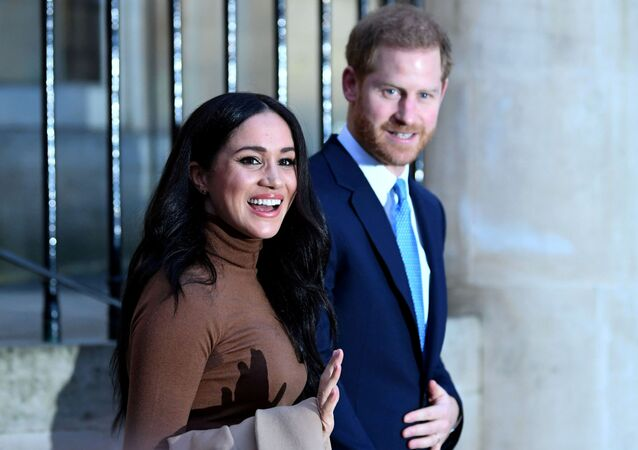 Britain's Prince Harry and his wife Meghan, Duchess of Sussex react as they leave after their visit to Canada House in London, Britain  January 7, 2020