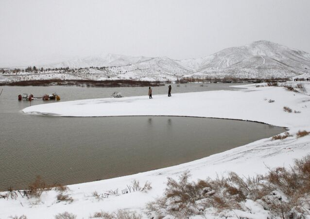 People visit the snow-covered Hanna Lake after a snowfall on the outskirts of Quetta, Pakistan January 12, 2020