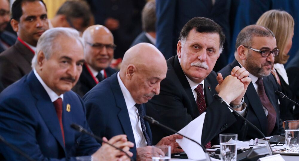 Libya Chief of Staff, Marshall Khalifa Haftar, President of the Libyan House of Representatives in Tobruk Aguila Saleh Issa, Chairman of the Presidential Council of Libya, Fayez al-Sarraj and President of Libya High Council Khaled Mechri, from left to right, attend an International Conference on Libya at the Elysee Palace with representatives of twenty countries, including Libya's neighbors, regional and Western powers and international organizations in Paris, France, Tuesday May 29, 2018. Libya's rival leaders meet in Paris to agree on a political roadmap including elections in an effort to bring order out of Libya's chaos, which is feeding Islamic militants, traffics of all kind and instability in the region.