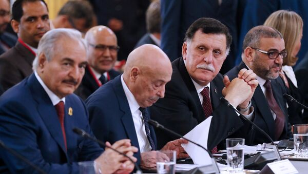 Libya Chief of Staff, Marshall Khalifa Haftar, President of the Libyan House of Representatives in Tobruk Aguila Saleh Issa, Chairman of the Presidential Council of Libya, Fayez al-Sarraj and President of Libya High Council Khaled Mechri, from left to right, attend an International Conference on Libya at the Elysee Palace with representatives of twenty countries, including Libya's neighbors, regional and Western powers and international organizations in Paris, France, Tuesday May 29, 2018. Libya's rival leaders meet in Paris to agree on a political roadmap including elections in an effort to bring order out of Libya's chaos, which is feeding Islamic militants, traffics of all kind and instability in the region. - Sputnik International