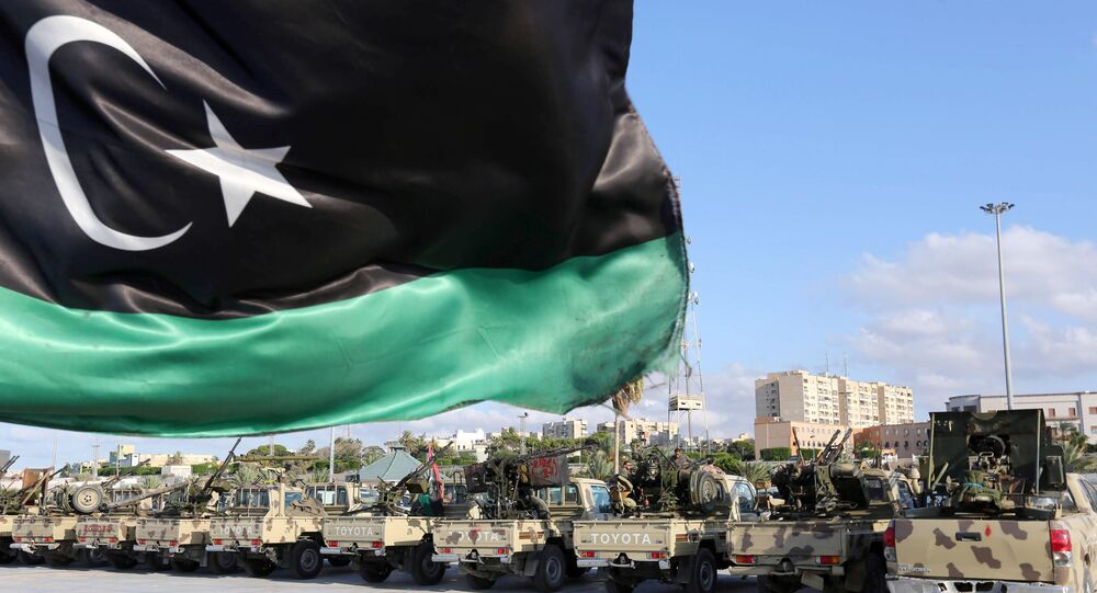 The national flag flutters as Libyan security gather in the capital Tripoli (File)