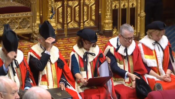 A still image taken from footage broadcast by the UK Parliamentary Recording Unit (PRU) on December 17, 2019 shows members of the Royal Commission in the House of Lords in a ceremony that starts the new parliament following a general election in London. - Sputnik International