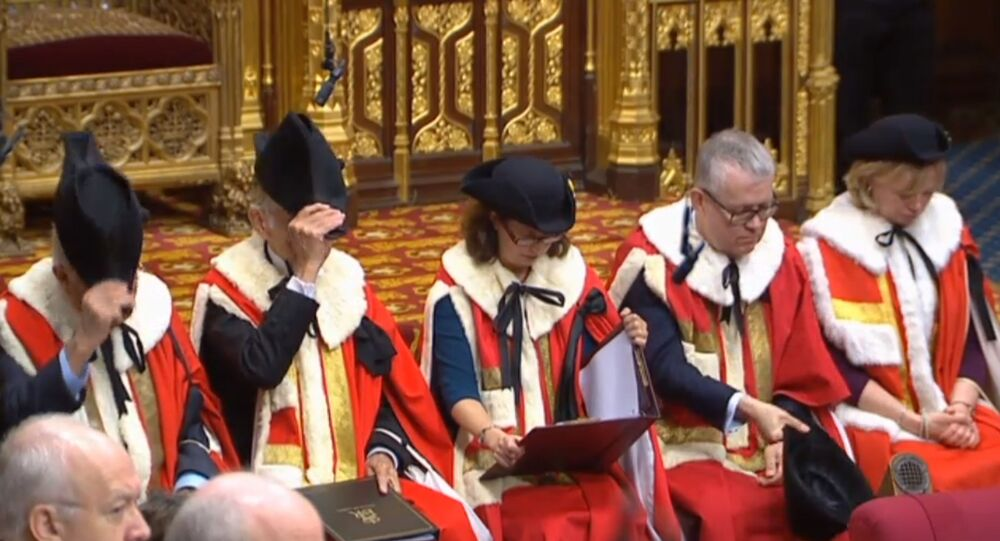 A still image taken from footage broadcast by the UK Parliamentary Recording Unit (PRU) on December 17, 2019 shows members of the Royal Commission in the House of Lords in a ceremony that starts the new parliament following a general election in London.