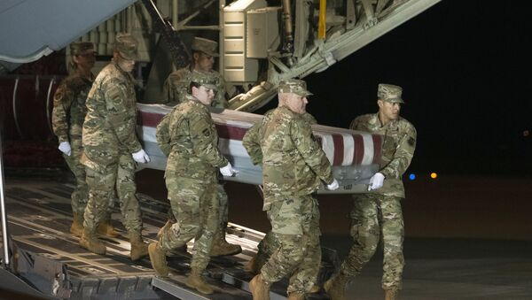 An Air Force carry team moves a transfer case containing the remains of Navy Ensign Joshua Watson on Sunday, Dec. 8, 2019, at Dover Air Force Base, Del. A Saudi gunman killed three people including 23-year-old Watson, a recent graduate of the U.S. Naval Academy from Enterprise, Ala., in a shooting at Naval Air Station Pensacola in Florida. - Sputnik International