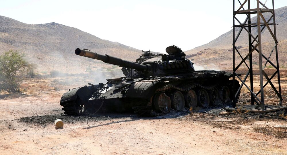 A destroyed and burnt tank that belonged to the eastern forces led by Khalifa Haftar, is seen in Gharyan south of Tripoli