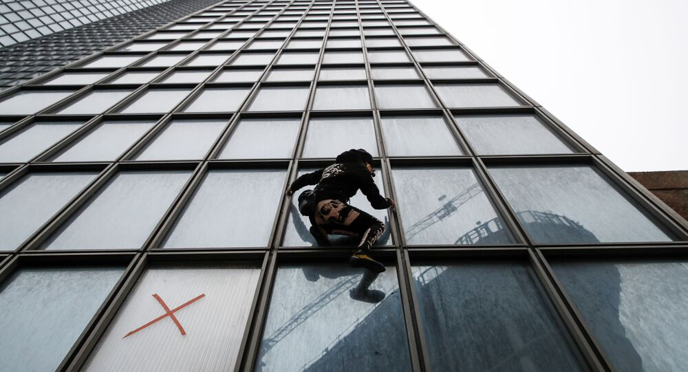 French climber Alain Robert, also known as Spiderman, scales the Tour Total skyscraper