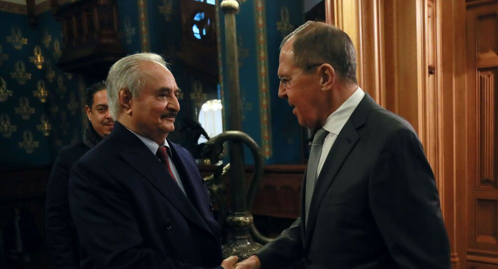 Commander of the Libyan National Army (LNA) Khalifa Haftar shakes hands with Russian Foreign Minister Sergei Lavrov before talks in Moscow, Russia January 13, 2020