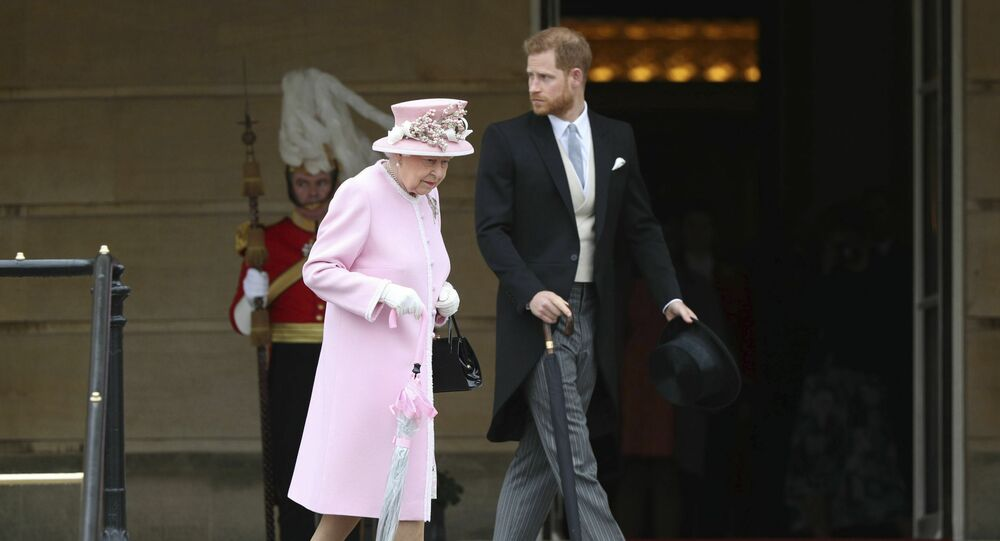 Britain's Queen Elizabeth and Prince Harry attend a Royal Garden Party at Buckingham Palace in London, Wednesday, May 29, 2019