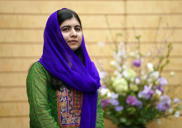 Nobel Peace Prize laureate Malala Yousafzai looks on before her meeting with Japanese Prime Minister Shinzo Abe at Abe's official residence in Tokyo, Friday, March 22, 2019