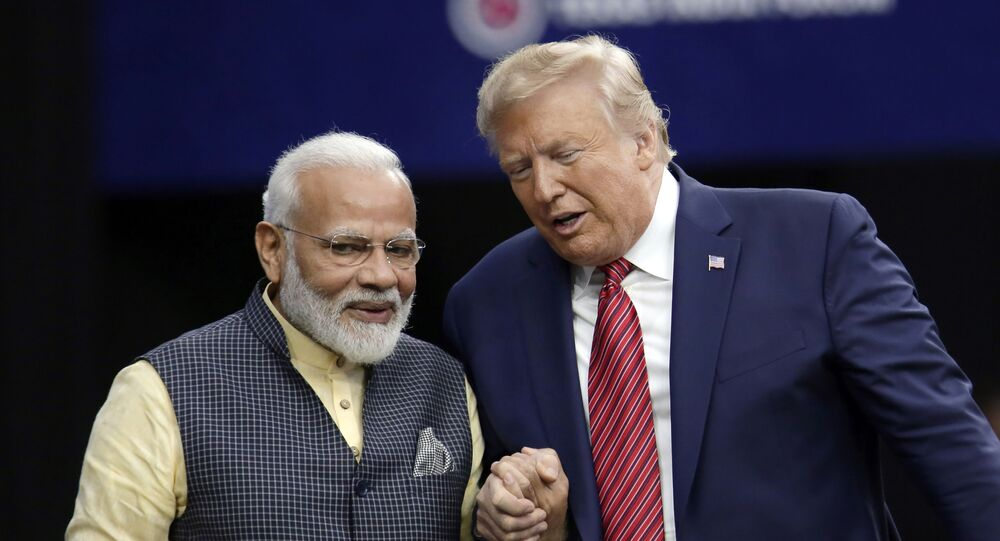 President Donald Trump shakes hands with Indian Prime Minister Narendra Modi during the Howdy Modi: Shared Dreams, Bright Futures event at NRG Stadium, Sunday, Sept. 22, 2019, in Houston