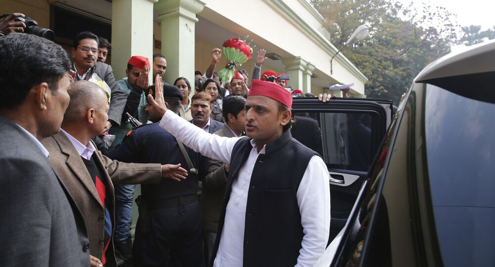 Samajwadi Party national president Akhilesh Yadav waves to his supporters as he arrives to address a press conference in Lucknow, India, Friday, Jan. 3, 2020