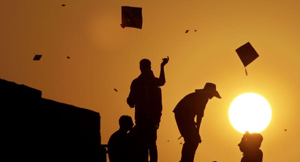 Indians fly kites during Uttarayan, or Makar Sankranti festival, in Ahmadabad, India, Saturday, Jan. 14, 2012