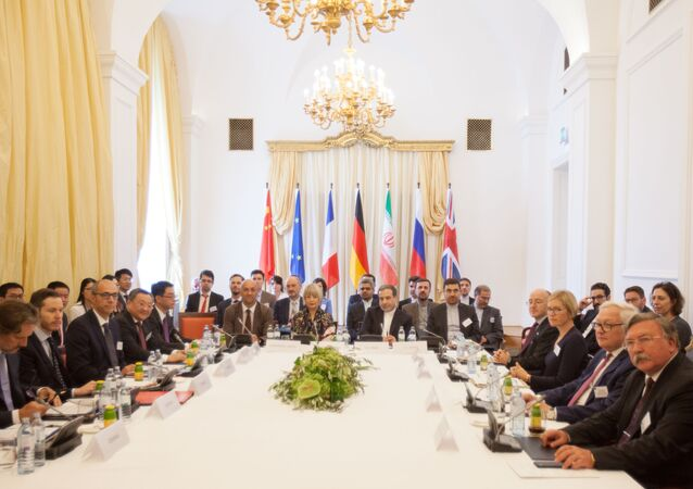 Abbas Araghchi (Center R), political deputy at the Ministry of Foreign Affairs of Iran, and Helga Schmid (Center L), Secretary General of the European Union's External Action Service (EEAS), take part in a meeting of the Joint Commission of the Joint Comprehensive Plan of Action (JCPOA) attended by the E3+2 (China, France, Germany, Russia, United Kingdom) and Iran on July 28, 2019 at the Palais Coburg in Vienna, Austria.