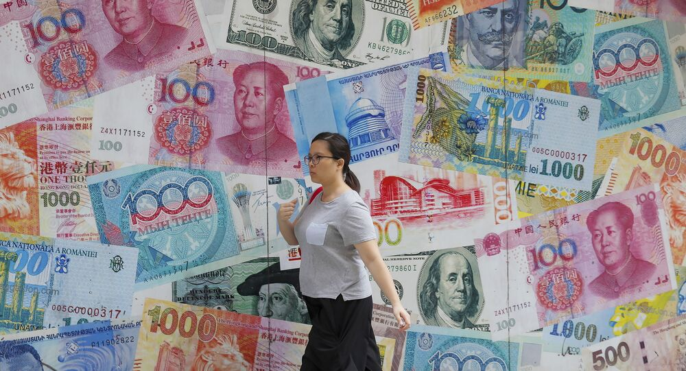 A woman walks by a money exchange shop decorated with different countries currency banknotes at Central, a business district in Hong Kong, Tuesday, Aug. 6, 2019