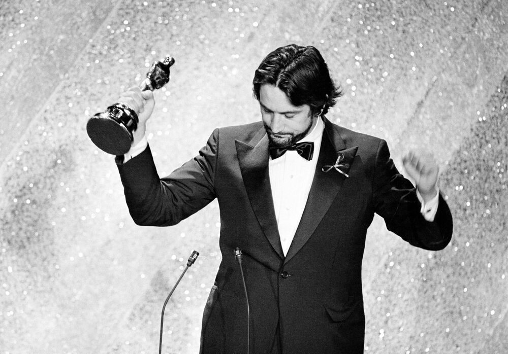 This photo shows De Niro accepting the Oscar for his performance in Raging Bull, at the 53rd annual Academy Awards show in Los Angeles, Calif., on March 31, 1981