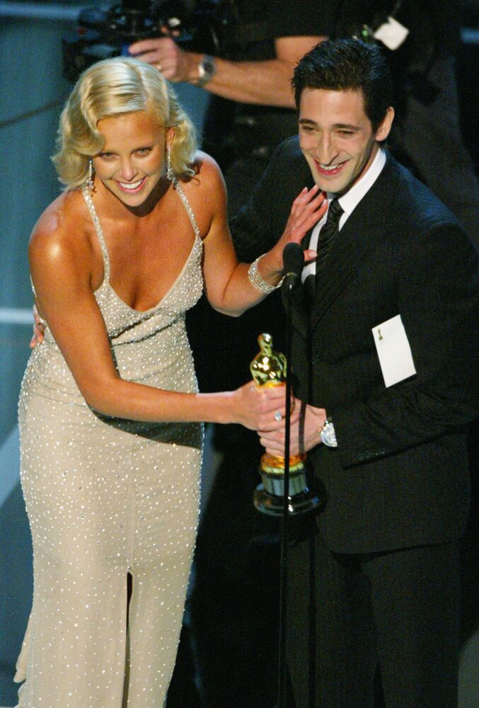 Actress Charlize Theron accepting the award for Best Performance and Actress in a Leading Role for Monster from actor Adrien Brody on stage during the 76th Annual Academy Awards at the Kodak Theater on February 29, 2004 in Hollywood, California.