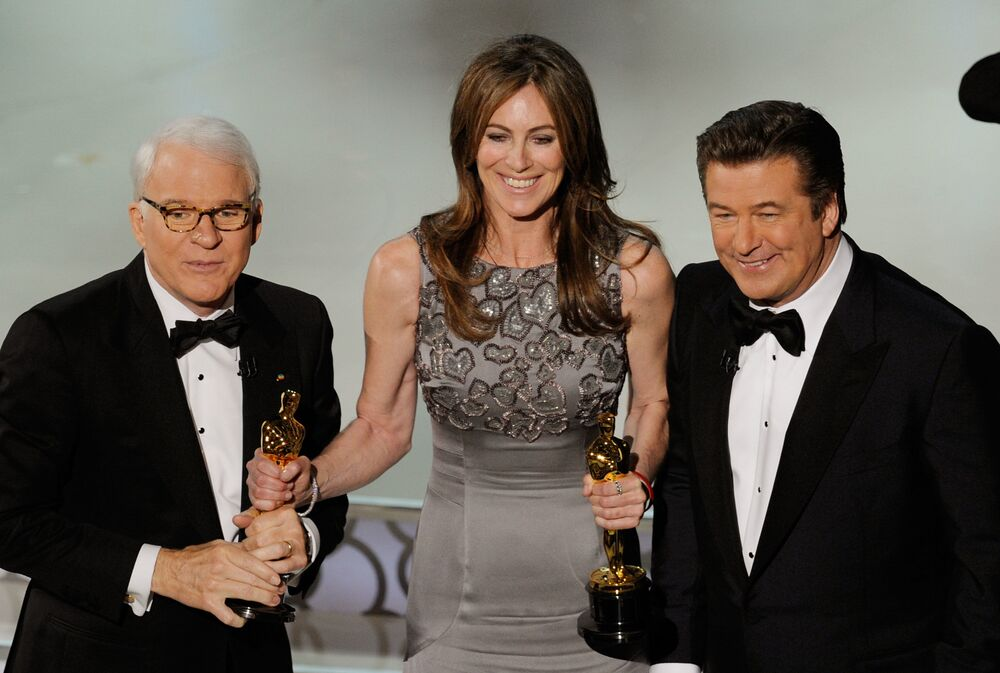 Director Kathryn Bigelow (C), winner of Best Director award for The Hurt Locker, with co-hosts Steve Martin and Alec Baldwin, onstage during the 82nd Annual Academy Awards held at Kodak Theatre on March 7, 2010 in Hollywood, California.