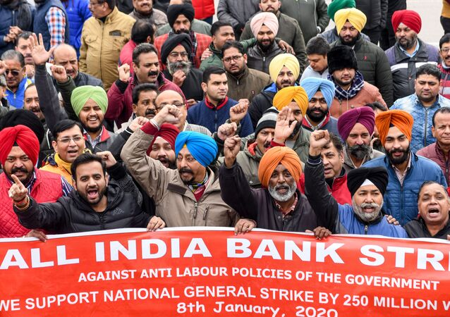 Bank employees shout slogans during a nationwide general strike called by trade unions aligned with opposition parties to protest against the Indian government's economic policies in Amritsar on January 8, 2020