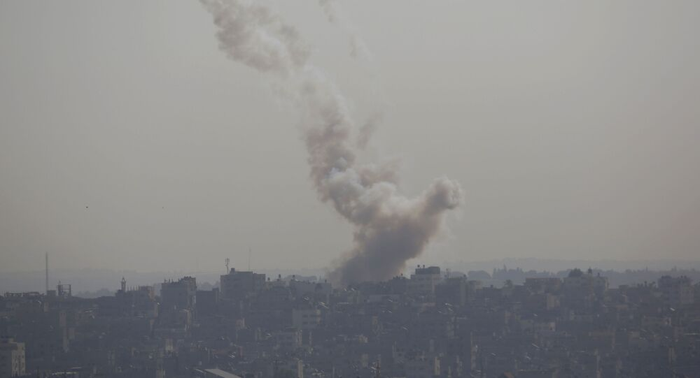 Smoke rises after an Israeli forces strike in Gaza City