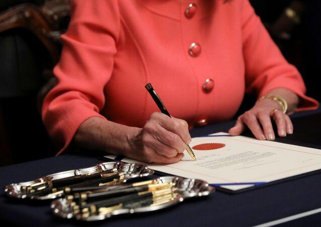 U.S. House Speaker Nancy Pelosi (D-CA) signs the two articles of impeachment of U.S. President Donald Trump