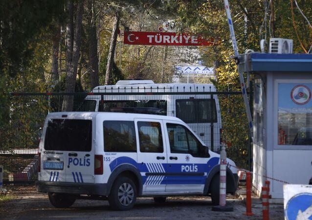 Turkish security cars stationed at the Turkey-Greece border gate near Pazarkule, Edirne, Turkey, Tuesday, Nov. 12, 2019