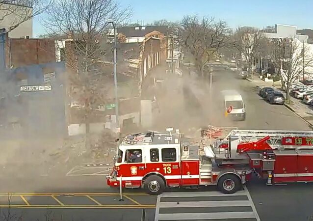 Building Suddenly Collapses Onto Sidewalk in Washington, DC