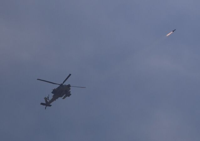 Israeli attack helicopter fires a missile into Gaza