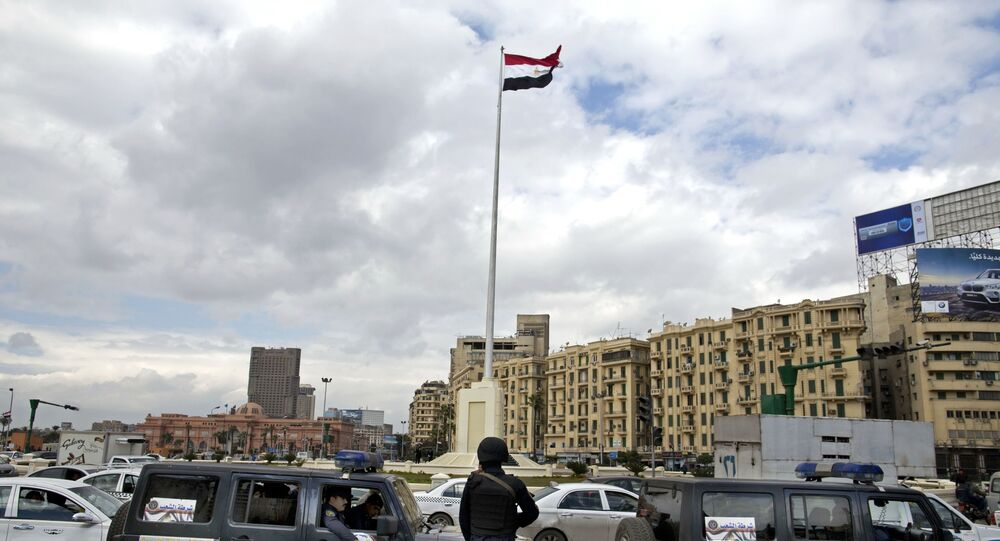 Egyptian police stand guard in Tahrir Square, Cairo